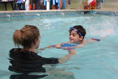 A young child learning to swim at an XUK Day Camp
