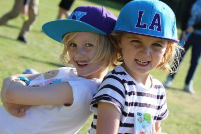 youngest campers wearing snapbacks smiling at uk sleepaway camps in england
