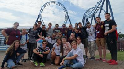 Teenagers and staff at theme park trip