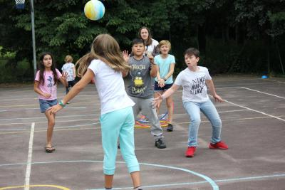 Children playing a ball game at summer camp