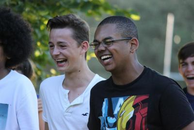 Teenage boys laughing at camp