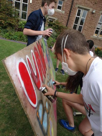 teenagers taking part in Spray painting activity at specialist activity camp in uk