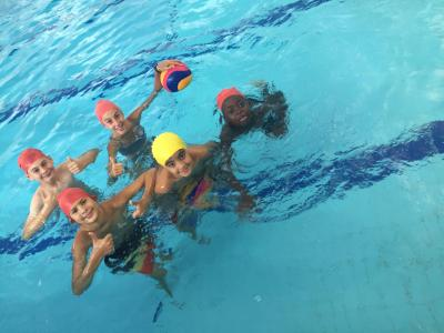 Campers in the swimming pool at summer camp for children and teenagers in england