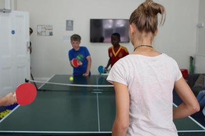 Children playing table tennis at XUK Excel