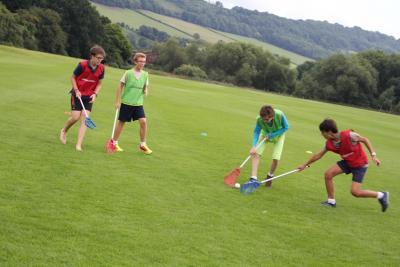 Teenagers playing lacrosse