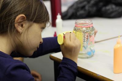 Girl during art activity at XUK summer camp
