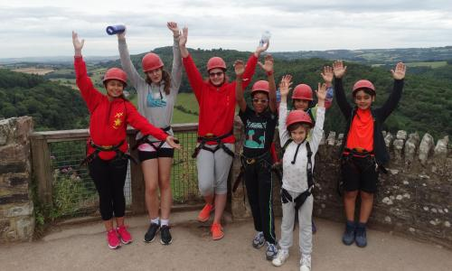 Children ready for climbing at summer camp