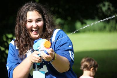 Happy staff member at Summer activity camp