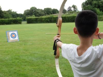 Boy enjoys archery at XUK English summer school