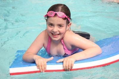 Girl swimming at day camp XUK and Mini Minors