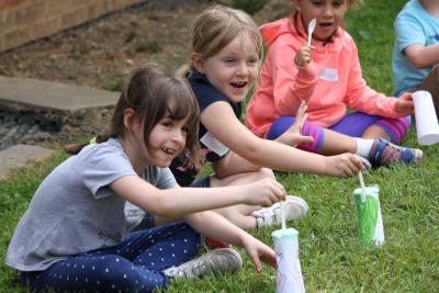 Girls with erupting volcanoes at day camp