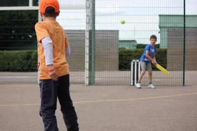 Boys playing cricket at UK Day Camp