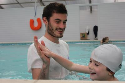 High five during swimming lesson