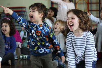 Children laughing at Mr Tickle the clown