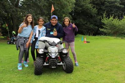 quad bike instructor with campers at XUK summer camp