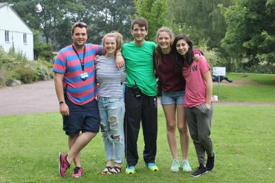 xuk staff looking like a happy family at residential activity camp