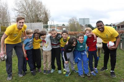 Boys and staff playing football with friends at north london playscheme