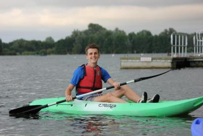 staff member on canoeing trip at specialist activity camp in monmouth wales