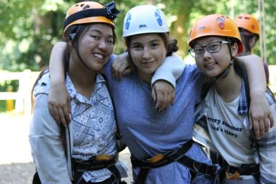 teenage girls climbing at activity camp in the uk near london
