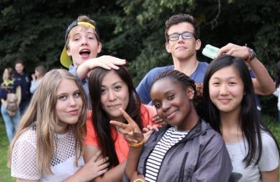 summer camp friends enjoying activities in uk learning english