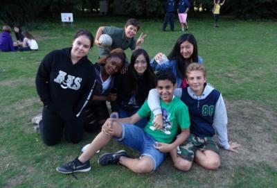 teenage boys and girls smiling at summer camp activity london uk