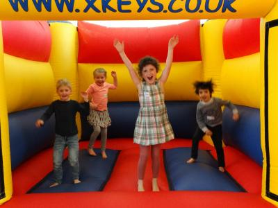 happy children bouncy castle activity day camp london uk