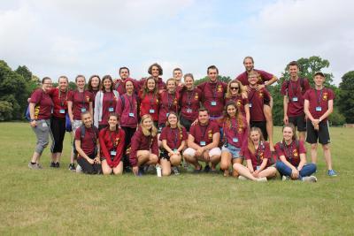 happy staff team at summer camp enjoying summer job in uk