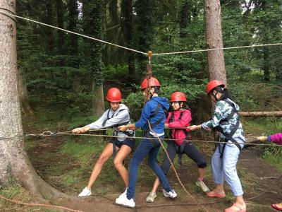 campers at water and forest adventure activities residential summer camp england