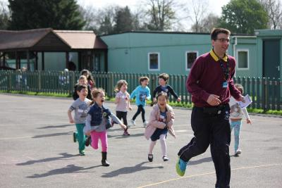 camp manager being chased by happy children
