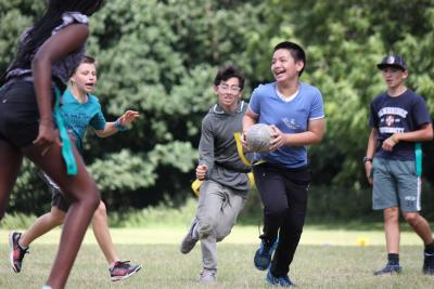 Teenagers playing rugby at uk summer camp in great britain