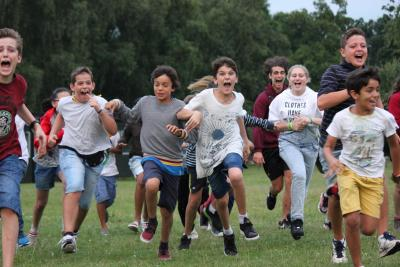Children running having a fantastic time at english speaking summer camp in England
