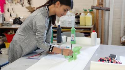 teenage girl painting at best summer camp in the uk