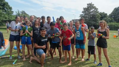 summer school students having a water fight at english summer school london