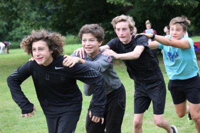 teenage boys playing games at summer camp in england