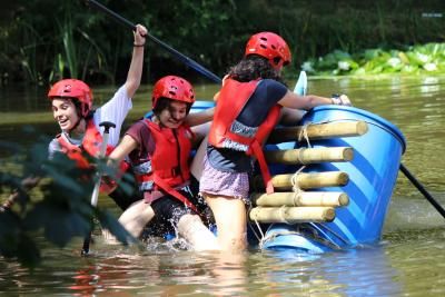 teenage girls raft building summer camp english uk london