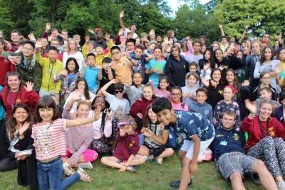 All of the happy campers and staff at summer camp