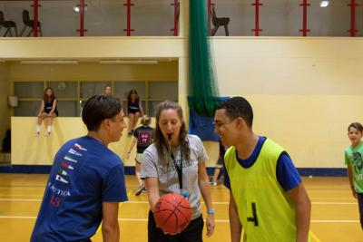 teenagers taking part in basketball activity at specialist activity camp in uk