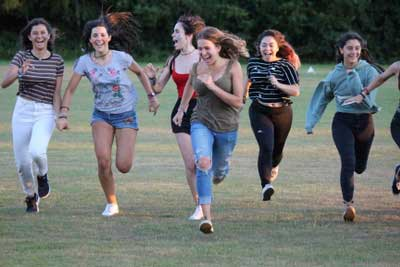 teenage girls running uk summer camp fun