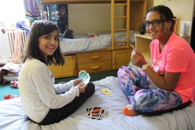girls playing cards at activity summer camp
