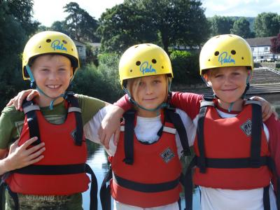teen boys kayaking british summer camp