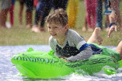 boy slip n slide summer camp uk london kids