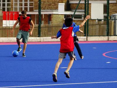 Boys playing football at XUK Excel activity camp